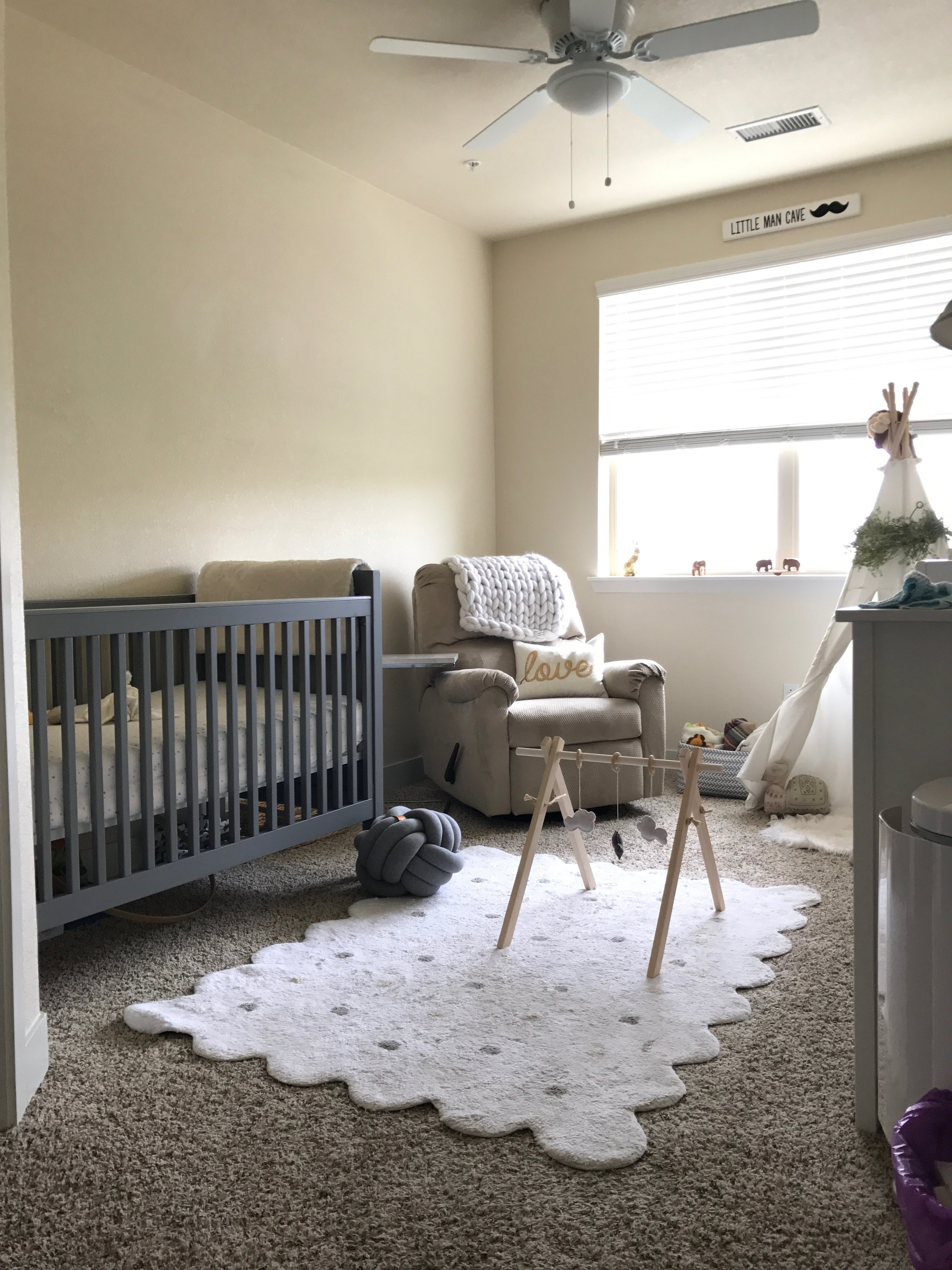Rug by  Lorena Canal s II Wooden Play Gym by  Alluring Co.  II Knot Pillow by  Juju & Jake