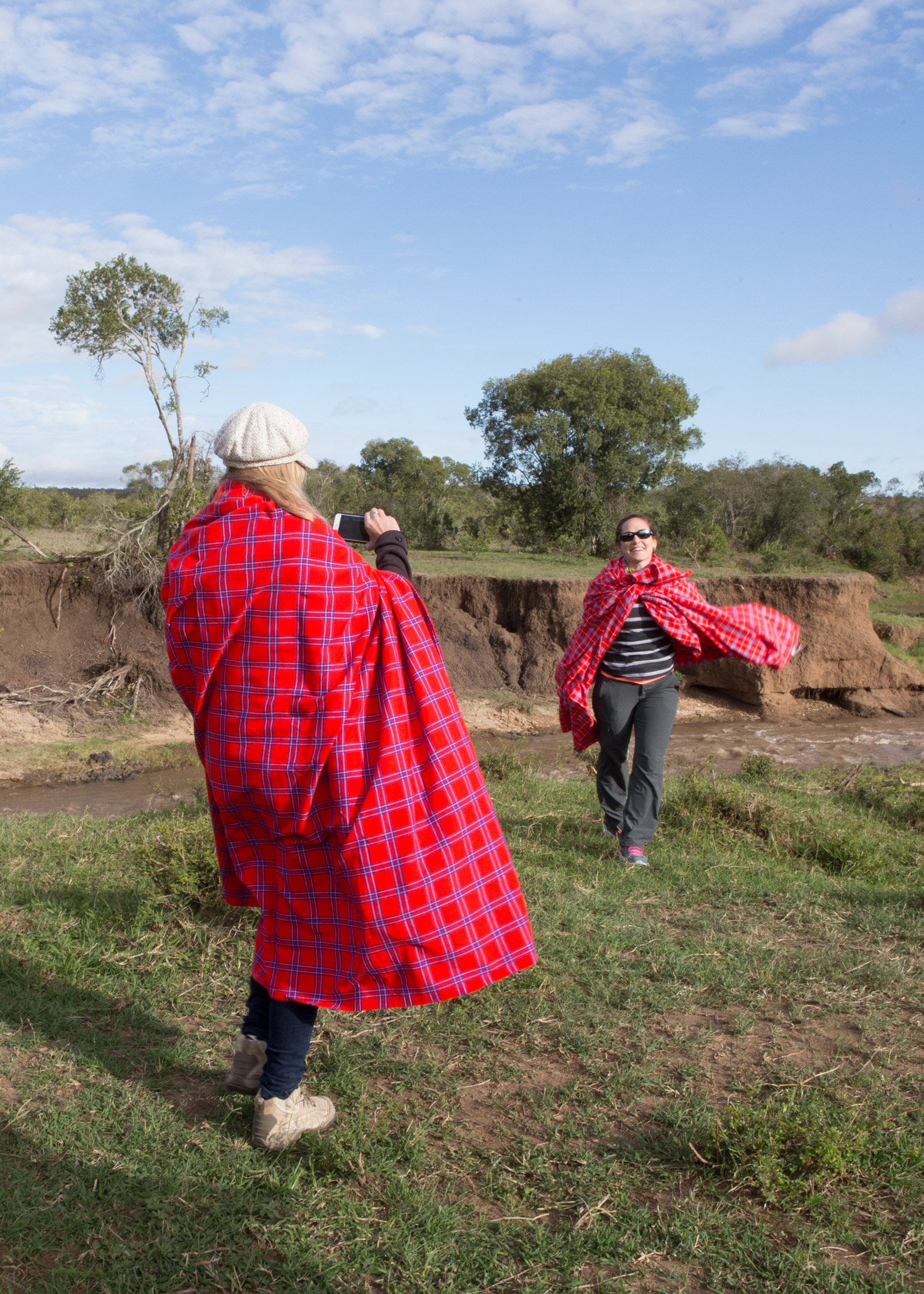 Two of our retreat goers snapping pics at breakfast wrapped in Massai blankets to keep warm