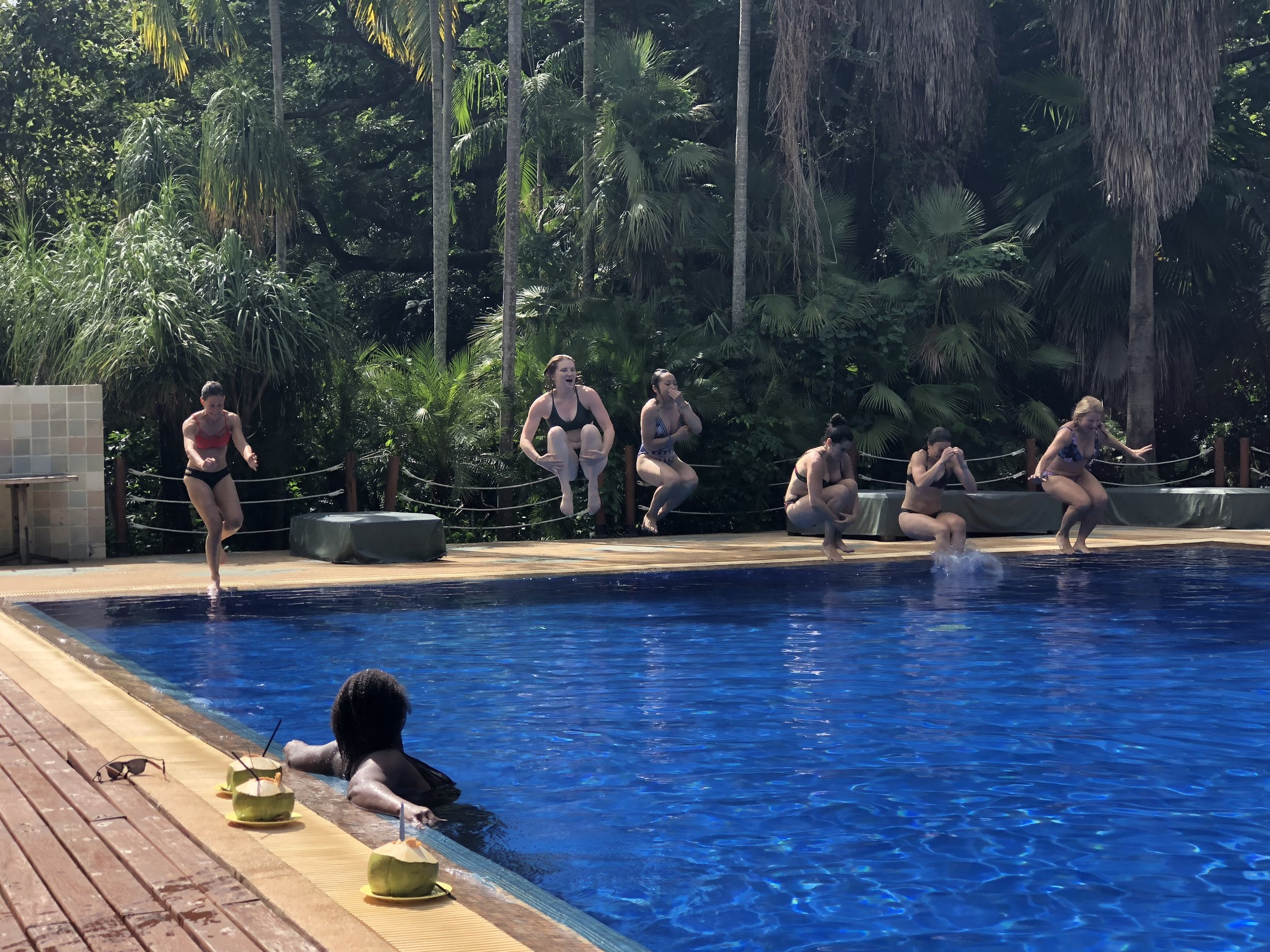 YTT enjoy bonding over a relaxing dip in the pool between sessions.