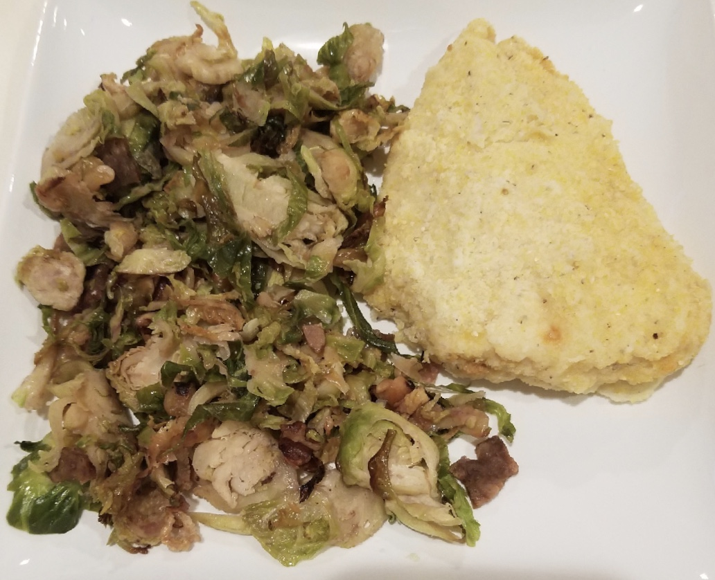 Metabolic Meals Parmesan-crusted chicken and shredded brussel sprouts with bacon, cornmeal.