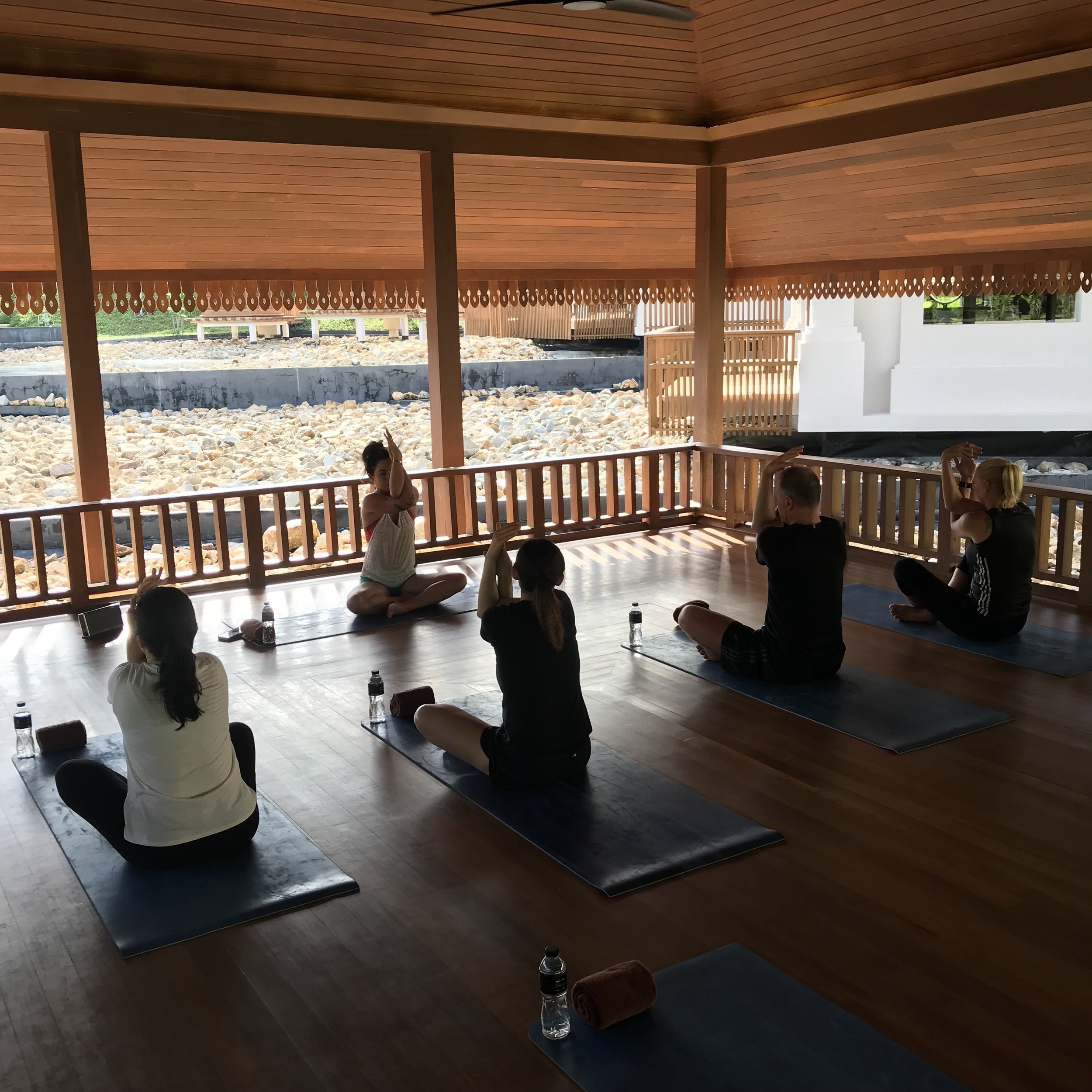 Yoga with Ritz-Carlton Koh Samui guests in their Spa Village