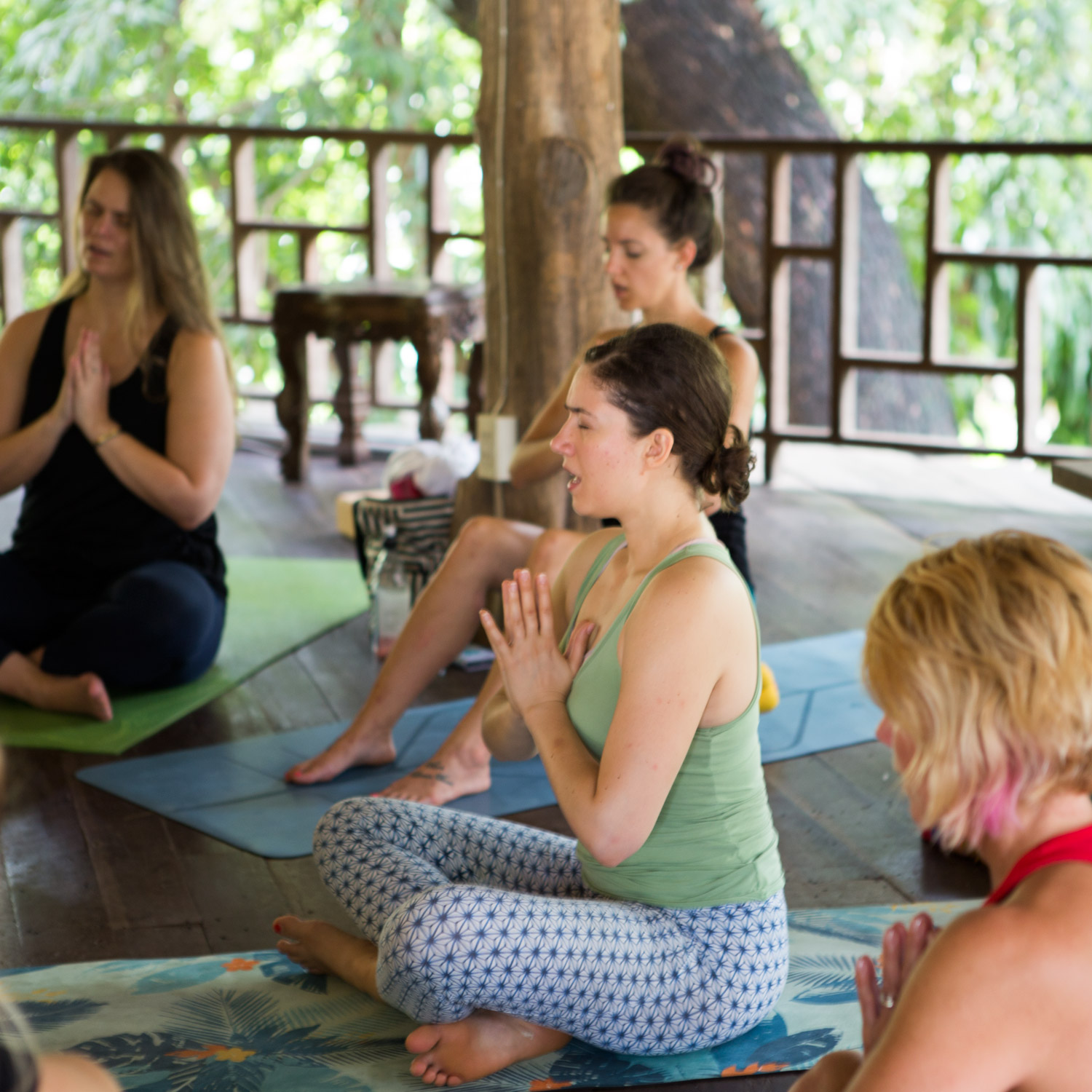 Prepping for meditation with chanting at our  Namaslay® 200hr Yoga Teacher Training Program