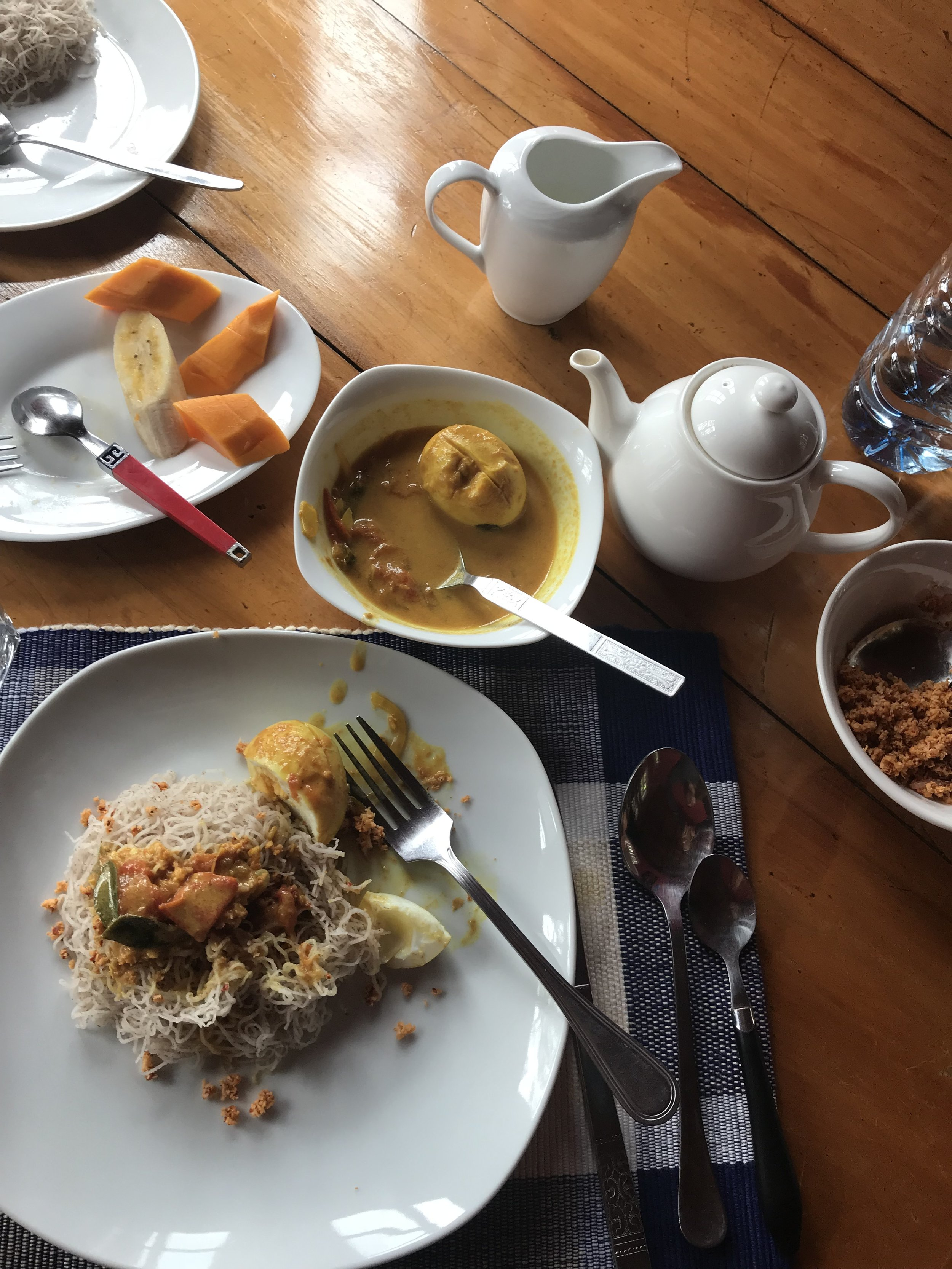 Breakfast provided by my hosts in Nuwara Eliya: string hoppers, curried eggs, fresh fruit and coffee