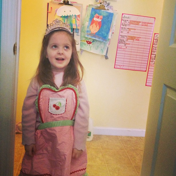 "Mya outside my workroom door. ""I'm a princess, but I wear this when I'm cooking!"""