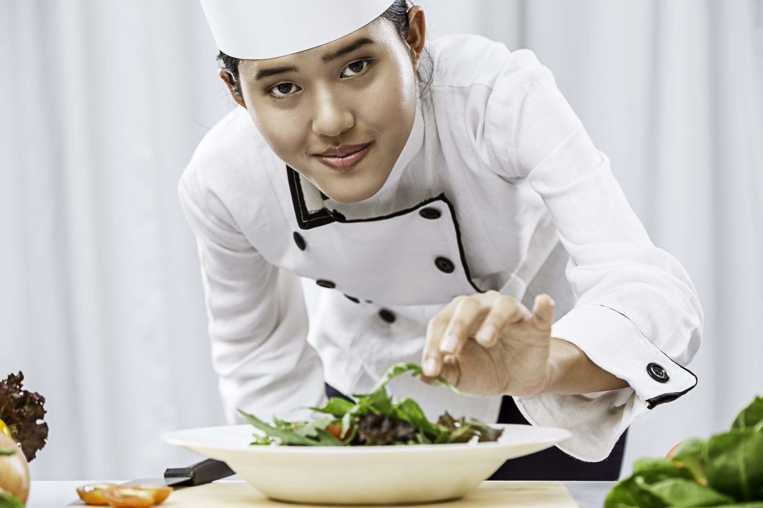 bigstock-chef-preparing-salad-109989908.jpg