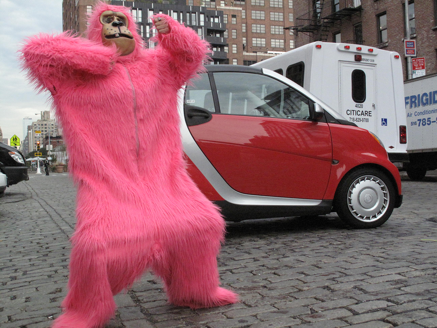 Me like Smart Car and bananas.  Krista appears as the pink gorilla body double in some shots in the commercial.