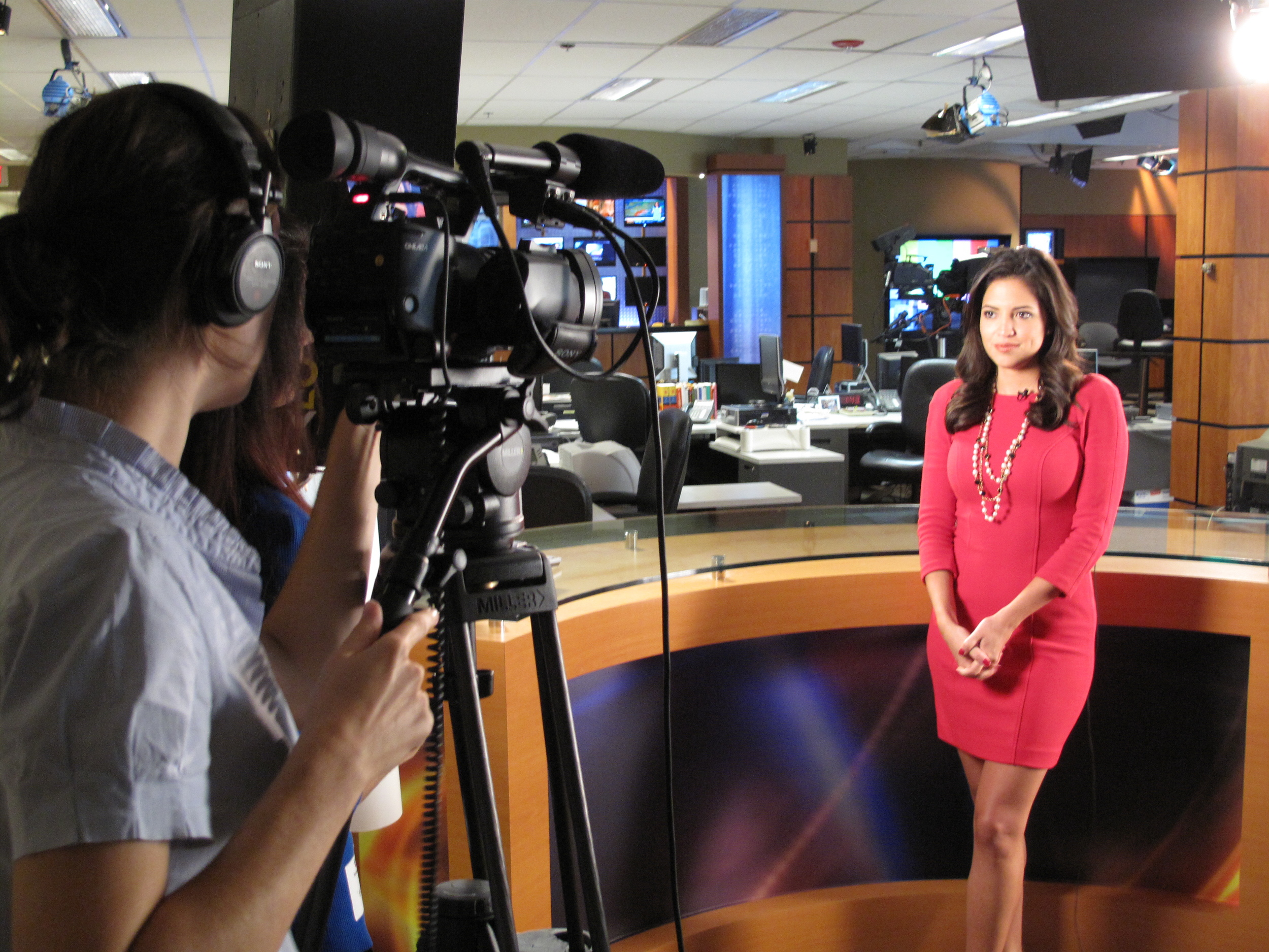 Anneliese shoots and Kyla directs a morning news anchor Pamela Silva Conde @ the Univision Studio in Miami.