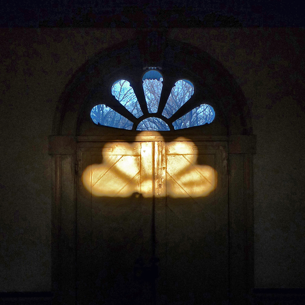 Fanlight and reflection in entry hall