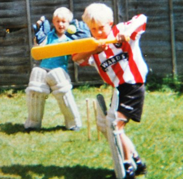 TRUE COLOURS:  BATSMAN JOE IN HIS UNITED SHIRTAND BROTHER BILLY KEEPING WICKET IN THEIRBACK GARDEN