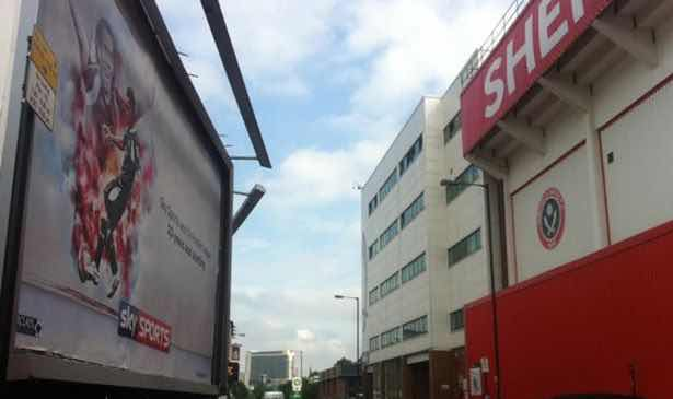 YOU'RE HAVING A LAUGH:  Sky Sports promotional poster on Bramall Lane featuring Carlos Tevez and THAT goal!