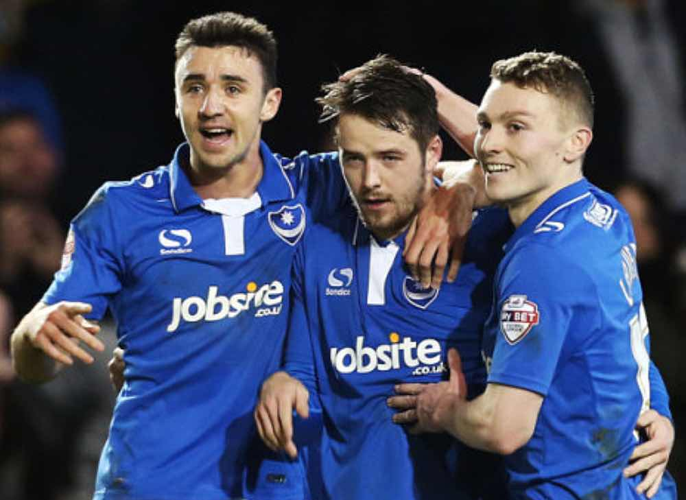 POMPEY CHIMES : MARC MCNULTY, CENTRE,CELEBRATES SCORING WITH CAOLAN LAVERY, RIGHT.   Pic: Joe Pepler