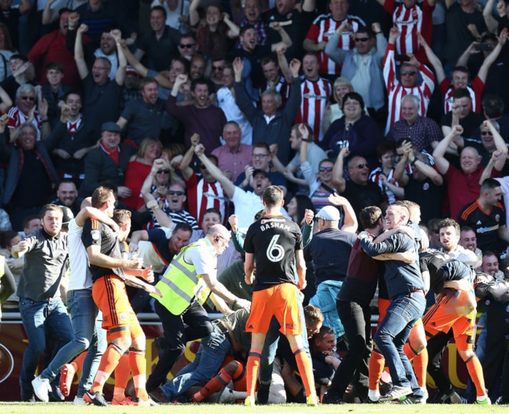 JOINING IN: BLADES FANS INVADE THE PITCH AFTER LEON CLARKE'S EQUALISER