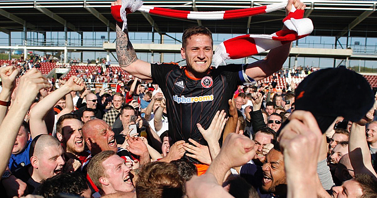 HE'S ONE OF OUR OWN:  LIFELONG BLADE BILLY SHARP CELEBRATES WITH delerious FANS at northampton.
