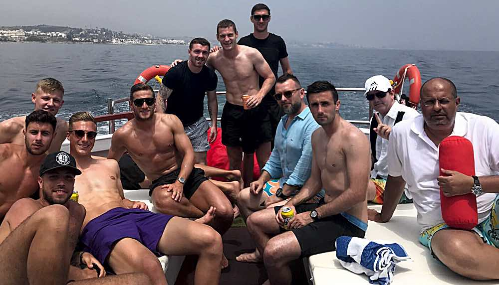 - United's squad relax on a yacht off Marbella but who's that princely-looking guy gatecrashing on the right clutching his money bag?