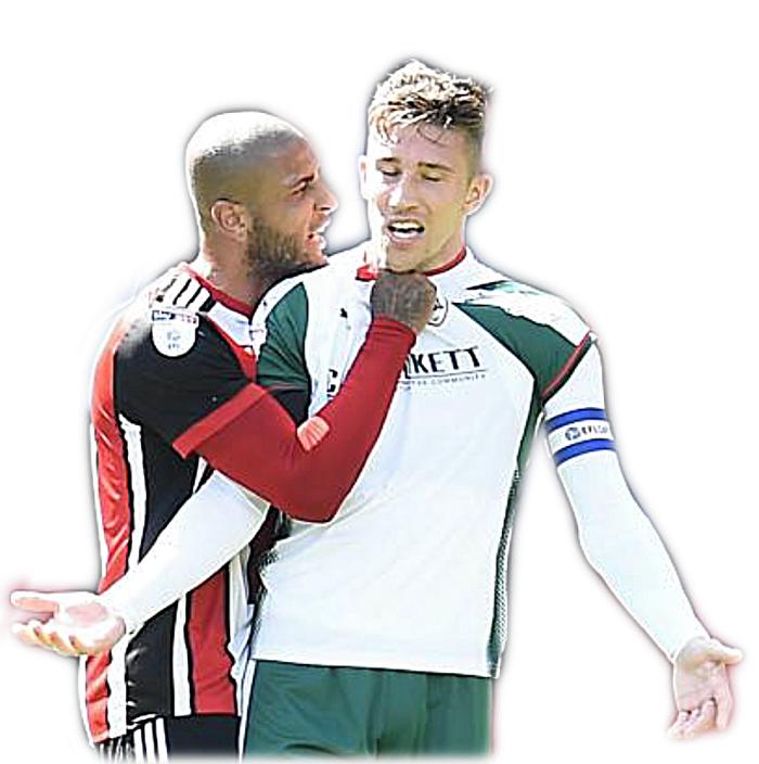 SEEING RED - Leon Clarke gets to grips with Barnsley skipper Angus MacDonald. Both were dismissed.