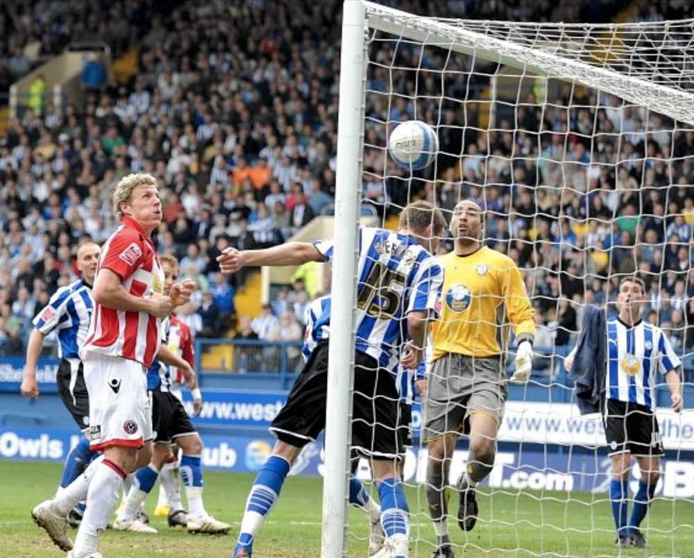 OUCH! - Wednesday defenders look on in horror as Lee Williamson (out of picture) equalises for the Blades at Hillsborough in April 2010, leaving the Owls in the Championship drop zone.