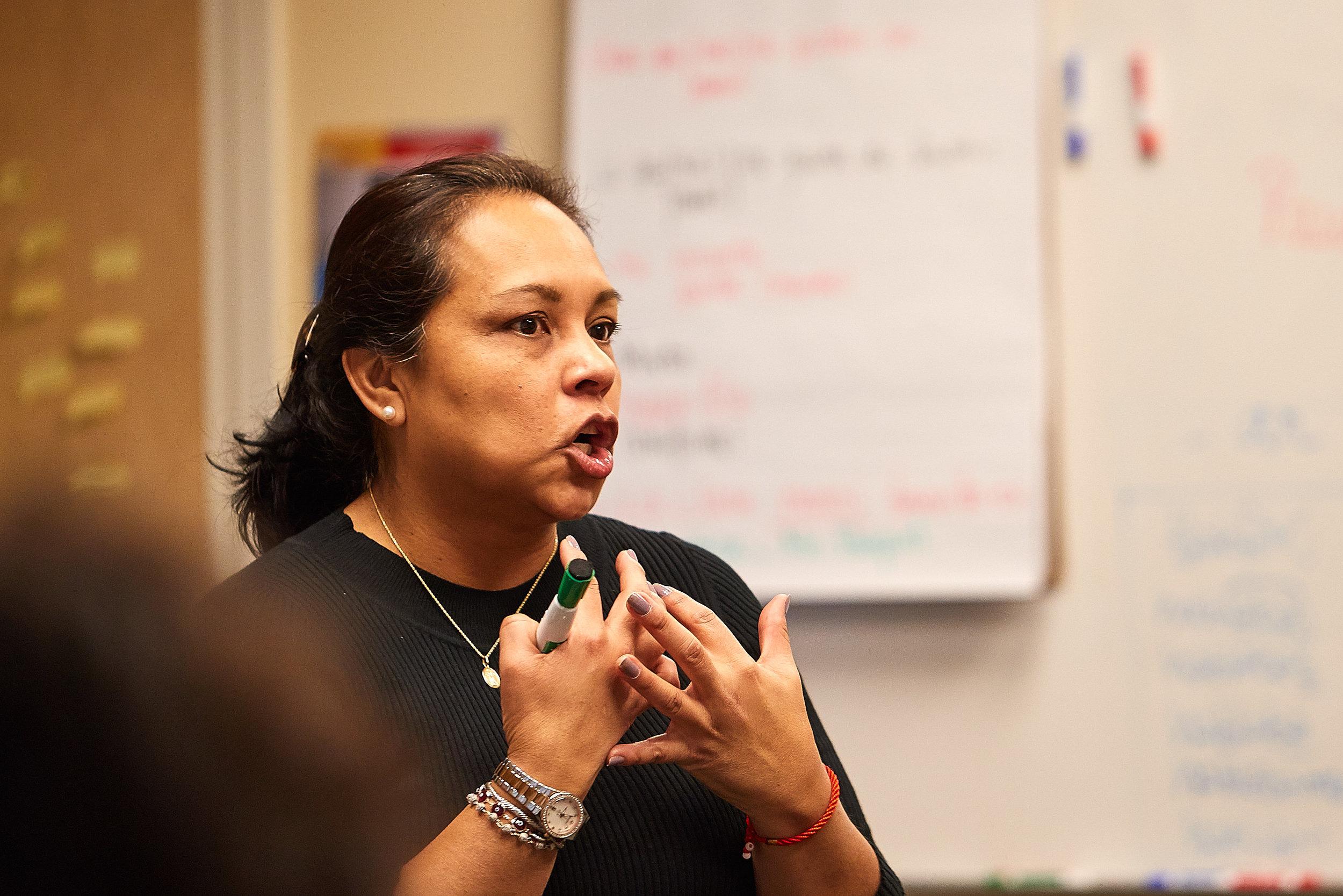 Bernarda Del Villar making a point to Spanish III students.