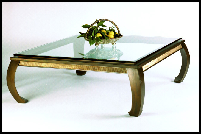 """Cocktail Table Size Shown: 50"""" x 50"""" x 20""""H Burnished Iron Finish with Bronze Apron"""
