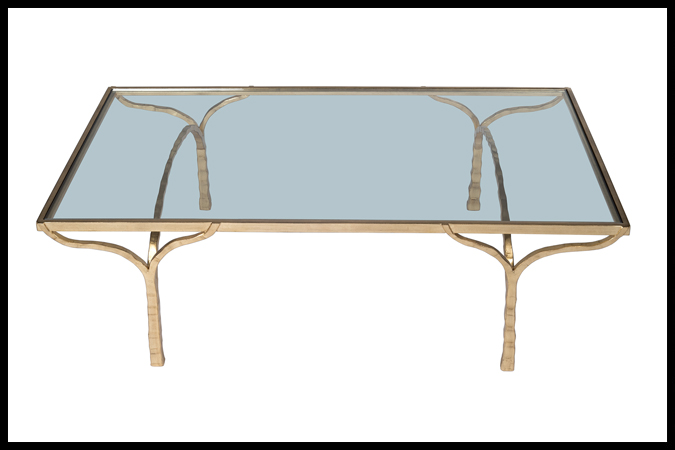 "Cocktail Table Size Shown: 28"" x 50"" x 16"" H Worn Gold Leaf with 3/8"" Glass."