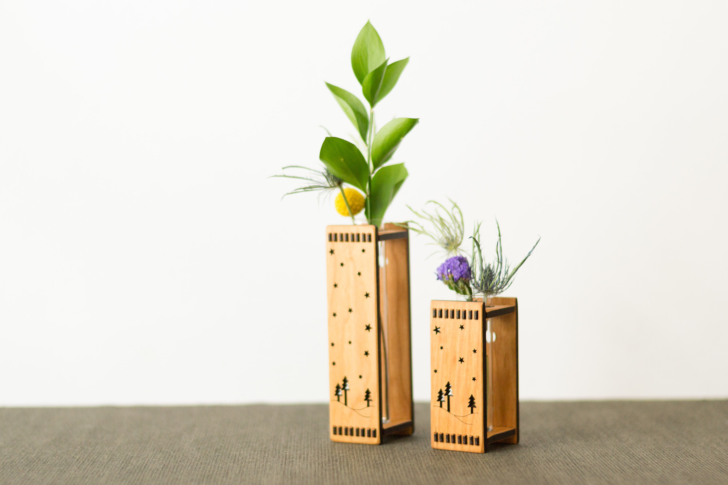 """Twilight bud vases, both small (3"""") and large (6"""")."""