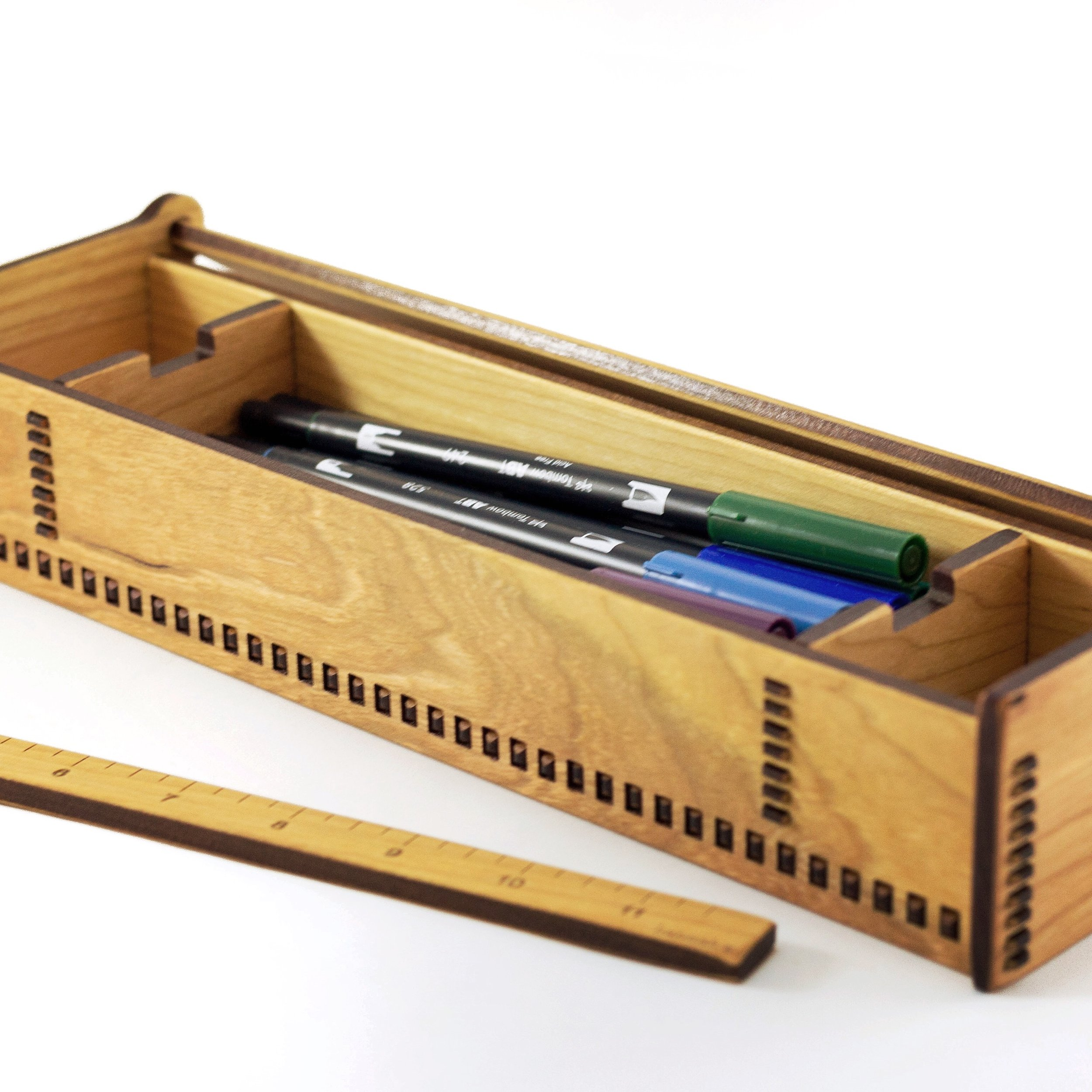 1. Ruler Box - The ruler box is designed to hold their most precious writing utensils, and the sticky notes, paper clips, or erasers they use most. Three compartments makes for easy organizing. This box is particularly useful for anyone (student or otherwise) who is enjoying the Bullet Journal trend!