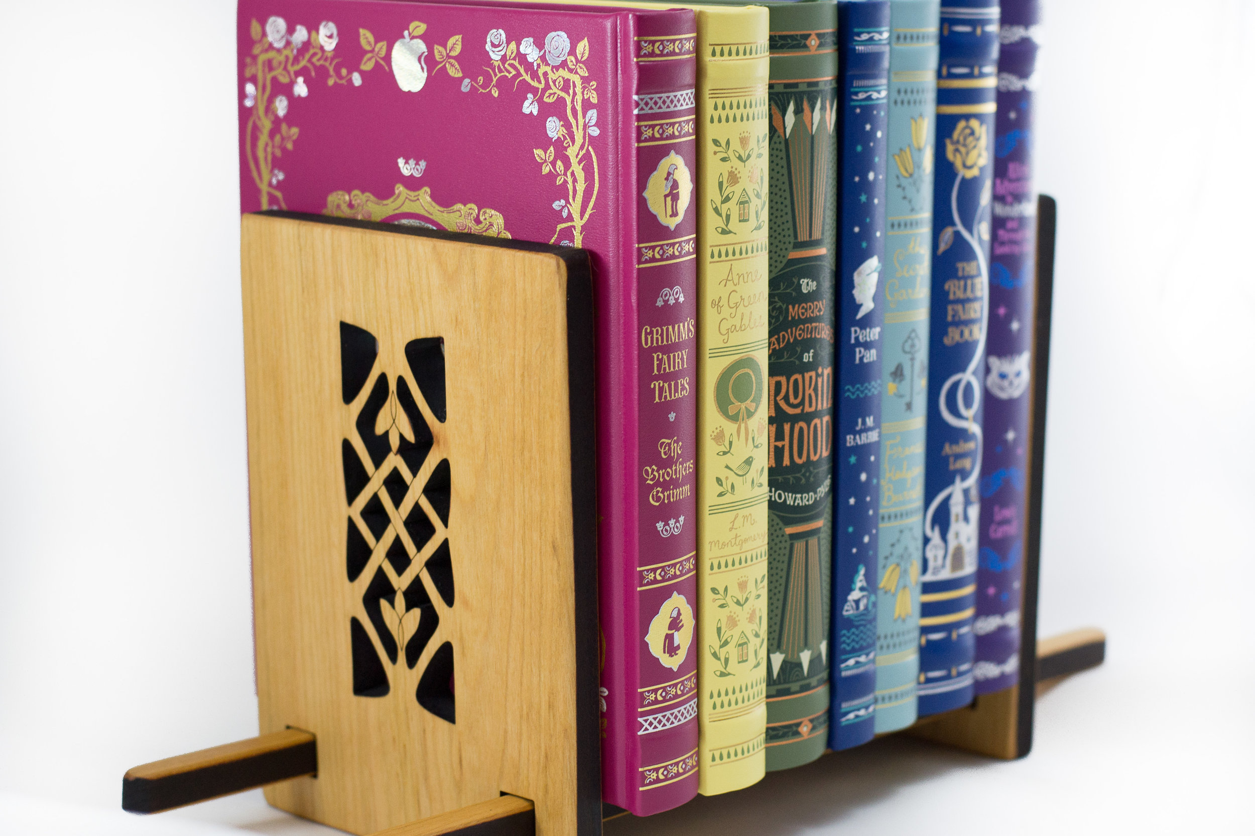 2. Sliding Book Stand - Keeps a few (or a few more) favorite books on hand. Adjusts to hold what is necessary. It's a small freestanding bookshelf.