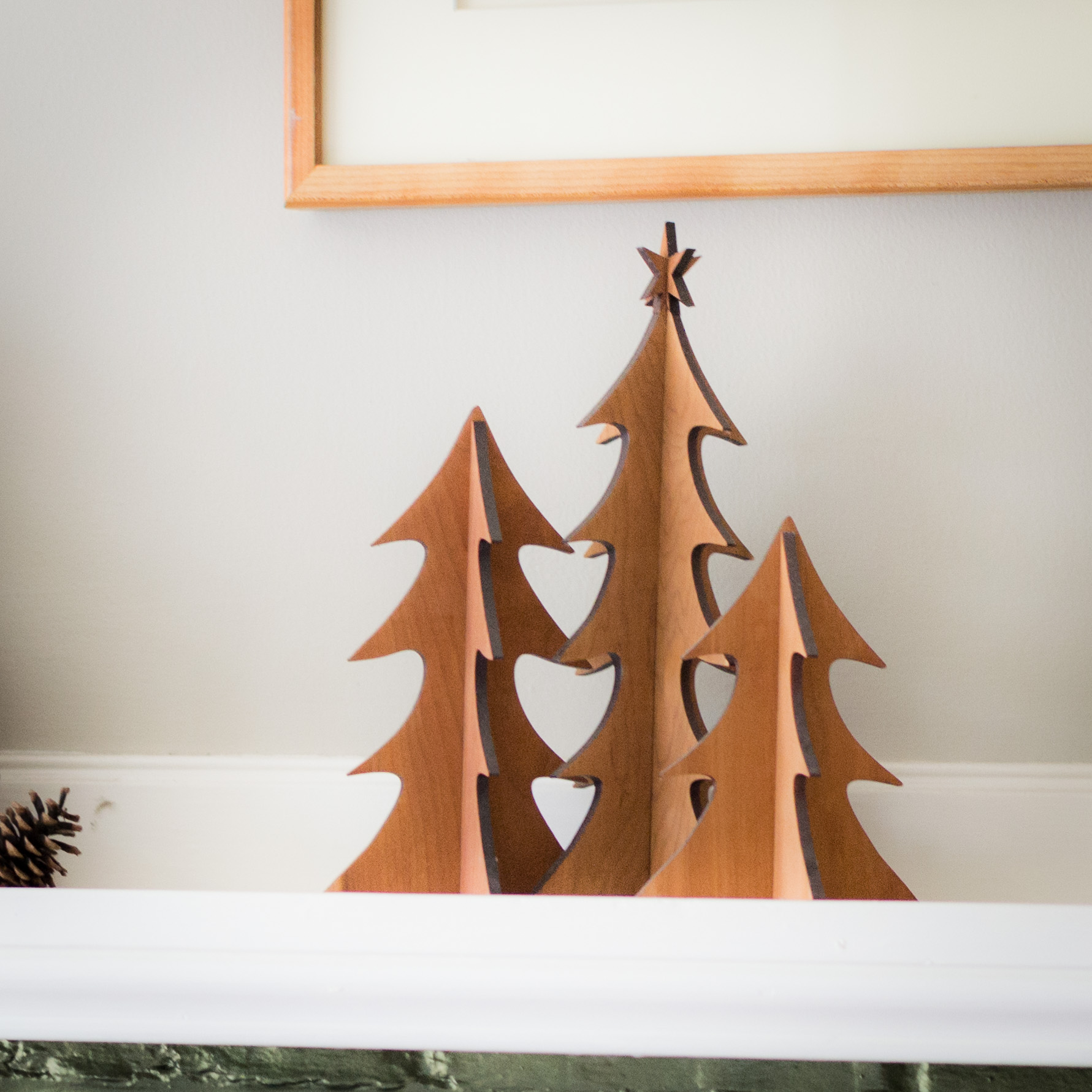 1. Set of Trees - Solid cherry wood trees gracefully decorate the table or mantle. The trees slot together making them easy to store, and easy to assemble.