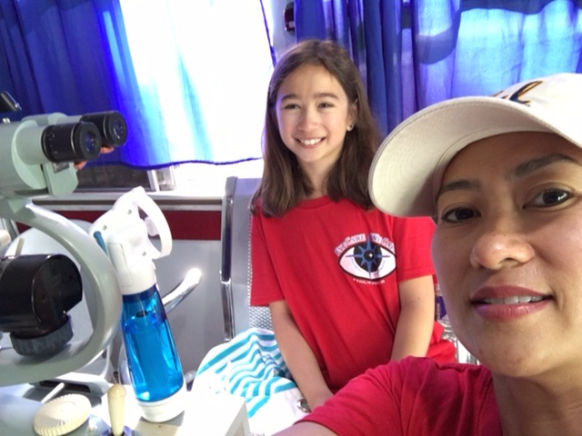 Selfie in the Mobile Eye Clinic.  Dr. Schmidt and her daughter Nina just getting started for the day.