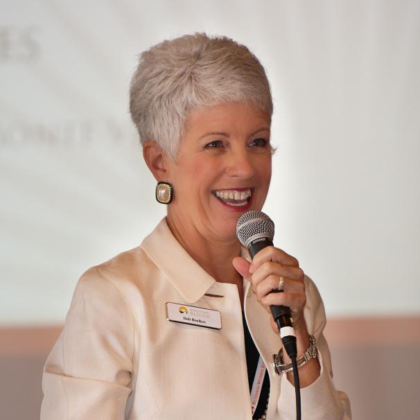 Deb speaking at Leadership Symposium