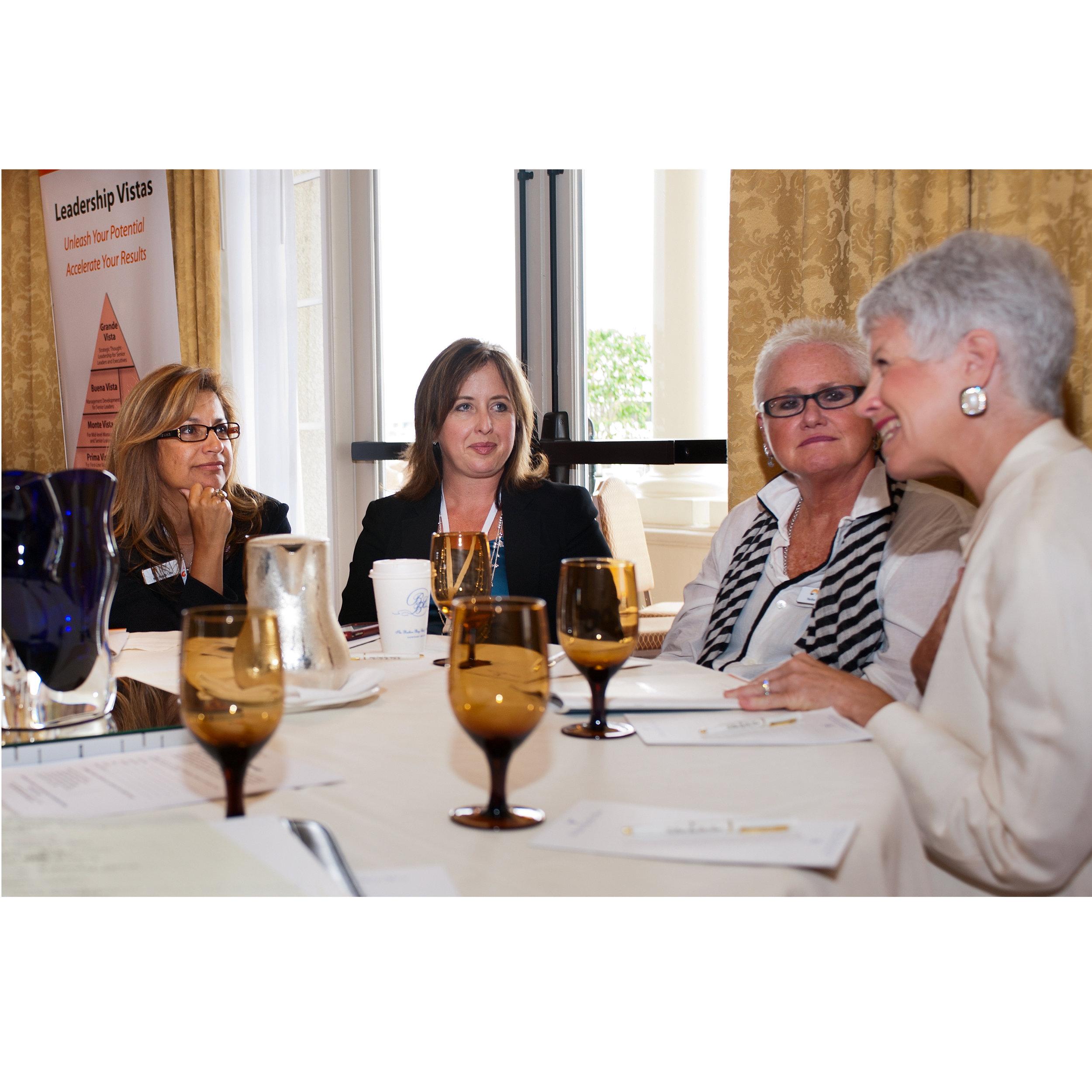 Deb Boelkes conferring with Leadership Vistas participants