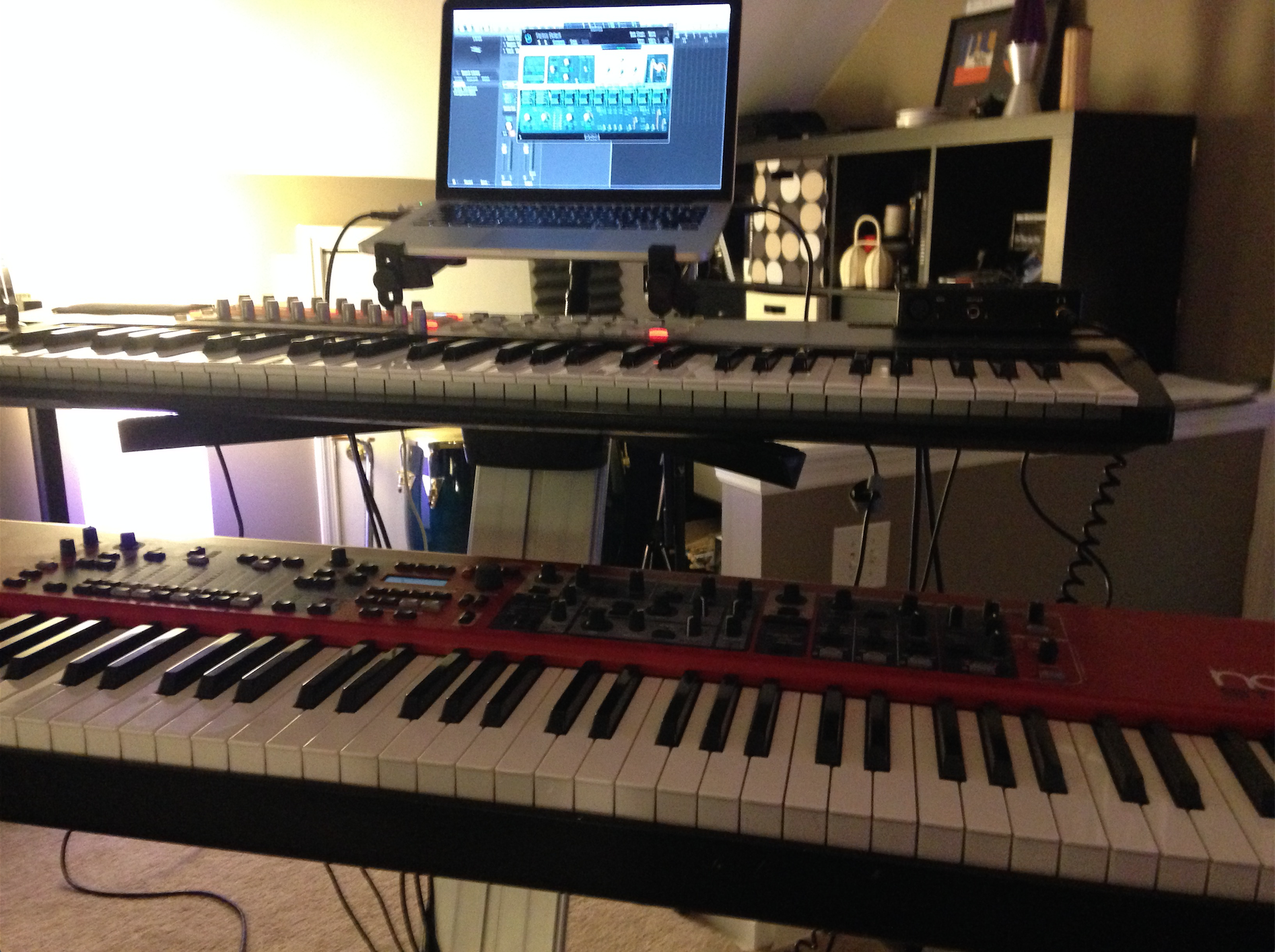 I opted to use my Nord Stage, Novation Remote SL 61, a MOTU MicroBook, and my trusty MacBook Pro running Logic Proon this session. Everything worked well, but I definitely could have simplified to just the Nord and a MacBook. Less is more when you're going for speed.
