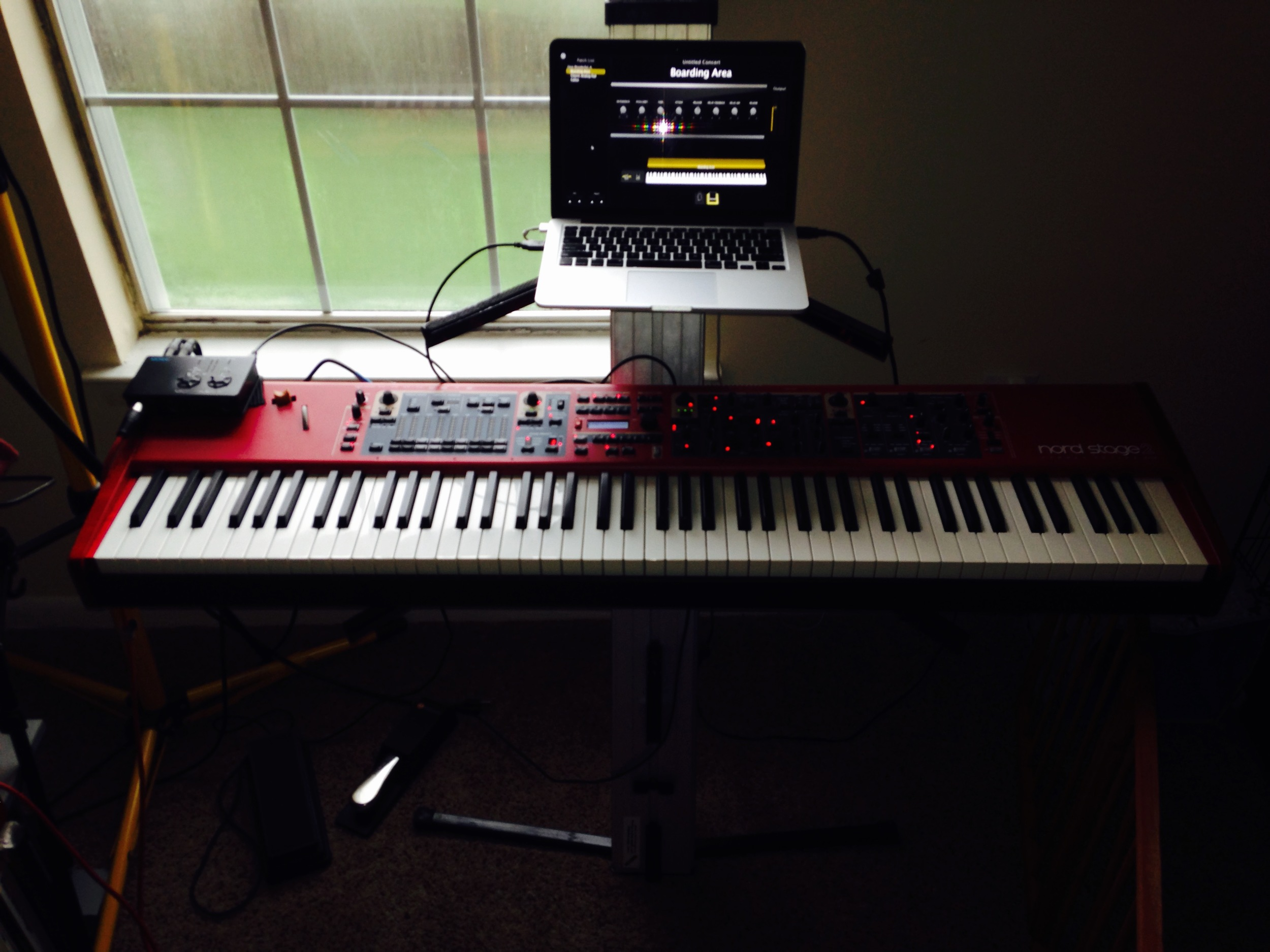 "My setup: I use a 13"" MacBook Pro 2014 running Mainstage 3.1. The keyboard is a Nord Stage 2, and everything runs into a MOTU MicroBook II. I use an Ultimate Support single column keyboard stand, M-Audio sustain pedal, and Studiologic volume pedal."