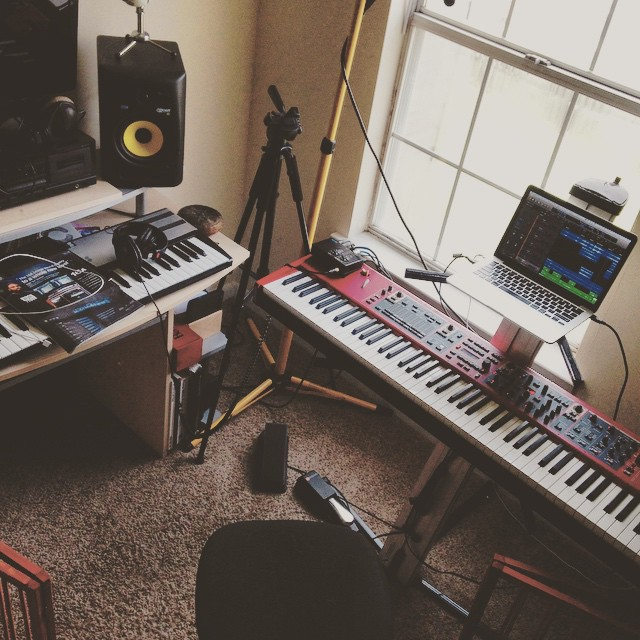My current studio setup, which I've put together for speed. Included in picture: Novation MK2 controller, Nord Stage 2, Rokit Speakers, and Logic Pro.