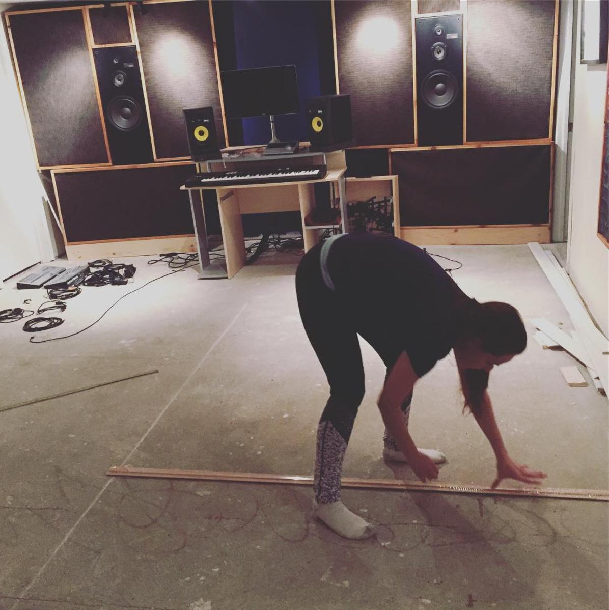 My wonderful wife Sarah helping me lay the floating floor in the studio.