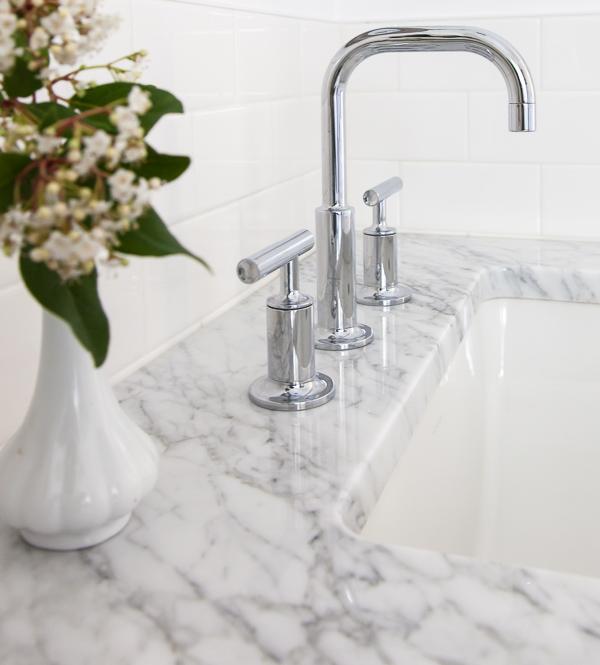 white + navy bathroom (sink detail): thehousediaries.com