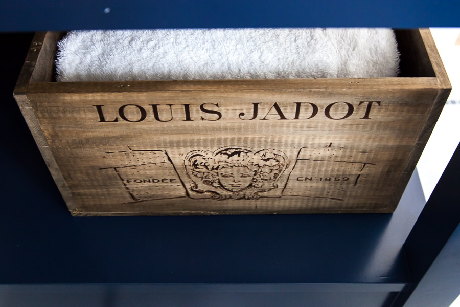 A wine crate-turned-towel-holder.