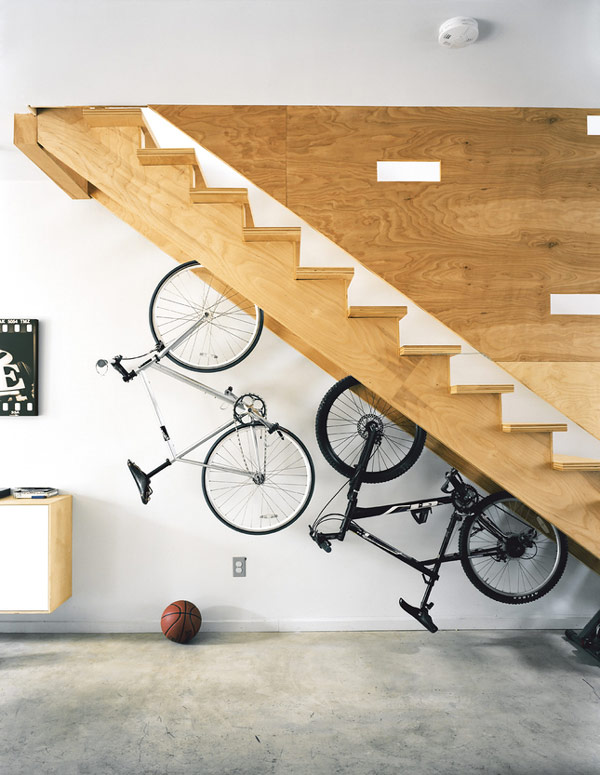 Keep bicycles off the ground and off the wall. Under the stairs bike rack makes for interesting decor and makes your space easier to clean.