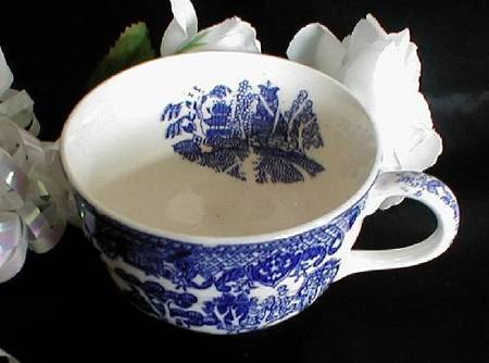 Blue Willow cup with inside design. A delicate surprise.