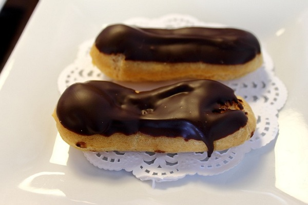 Traditional Mini French Chocolate Eclairs handmade from scratch in shop by Stephanie Fischer of Comet Coffee in St. Louis.  Photo by Michelle PG Richardson ©