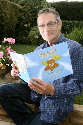 "Grandpa Super Bear, Bruce King, reading a copy of his first children's picture book ""How to be a Super Bear"", now available for free download.  Click this photo and go to the bottom of the page to receive your free copy."