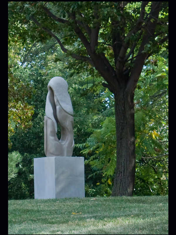Aria sculpture  – installed at the Northshore Sculpture Park in Skokie, IL. Artist: Carl Wright ©      This sculpture is on loan and will be there until 2013 and is part of sculptor Carl Wright's musical series.  Aria  is seen as a singer, well-trained and confident, opening her mouth to start singing a solo aria in Opera. Aria is about being a confident person in a competitive environment. The reason for thinking  Aria  belongs in an opera genre is the stippling of the upper third of the sculpture and also the sweeping lines which connotes a sweeping costume.
