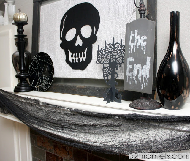 Black construction paper or felt silhouettes of a pumpkin, a witch, a cat, a skull. on a framed newspaper background, and voila, perfect for the  mante l.