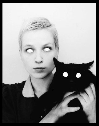 Not spooky enough?  Cut out the eyes  and place a blank white paper behind them for an eery effect to an otherwise normal photograph of you and your cat.