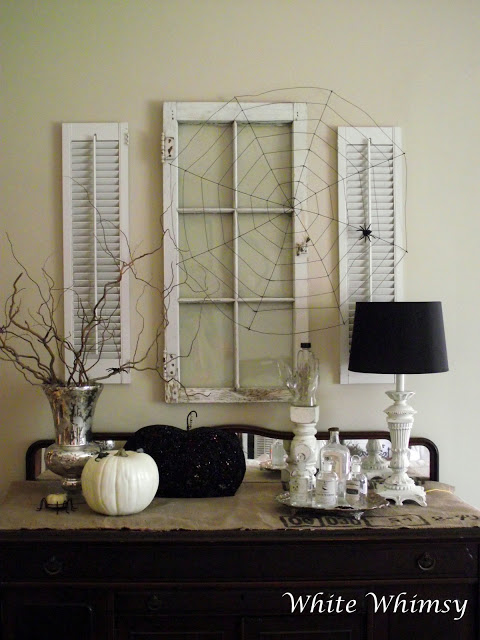 The only thing missing from these white  shutter and window frames  is some black and white Halloween photos and art. But it's a great idea for re-purposing and adds nice eye catching depth, texture, and character to your spooky decor.