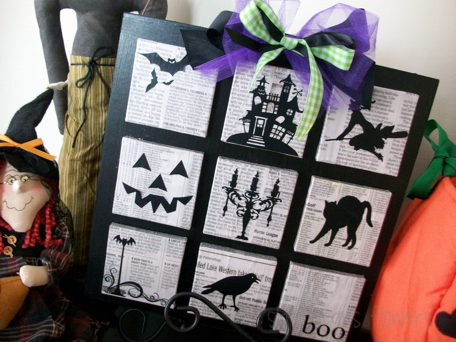 Spooky silhouettes on newspaper  with a touch of Halloween colored ribbon. Perfect.