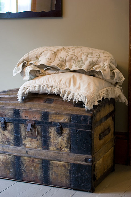 antique trunk with pillows.jpg
