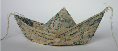 paper boat with buttons and string