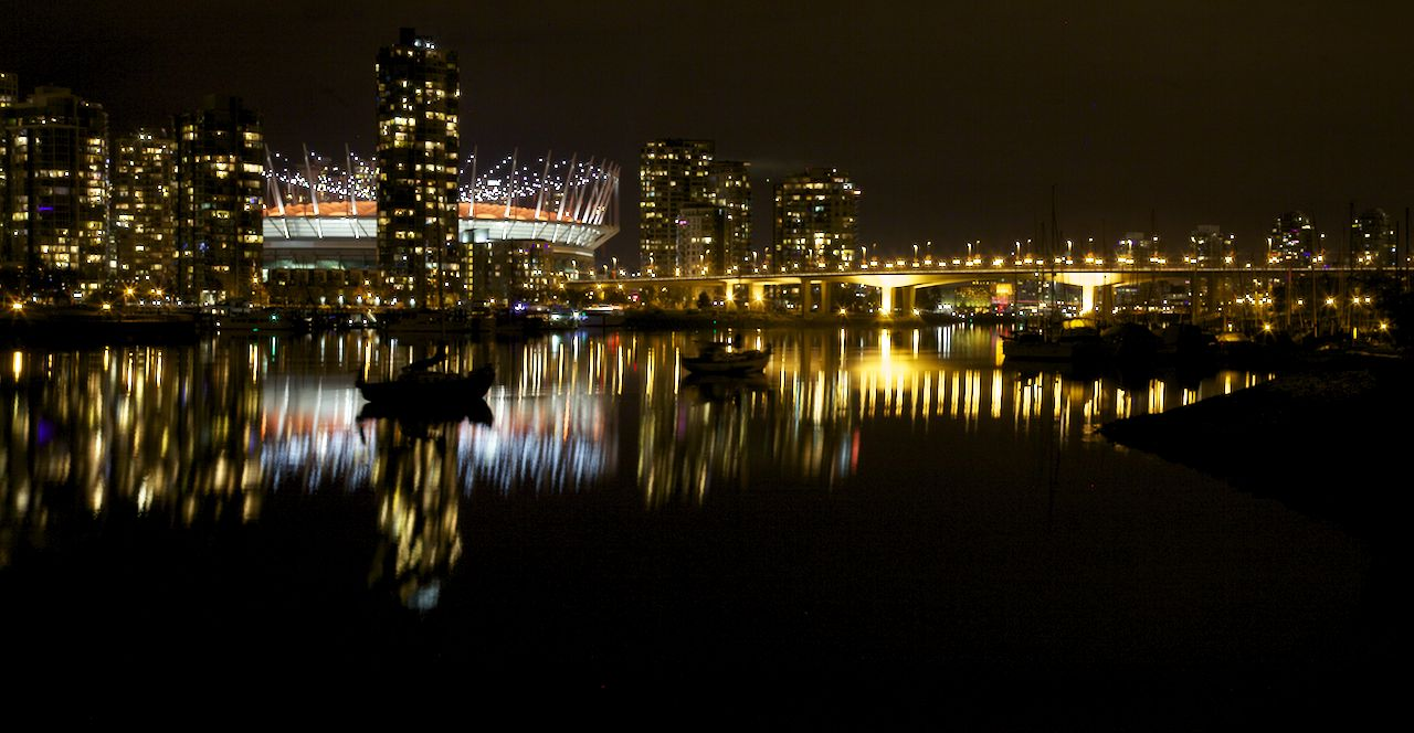 BC Place reflected in False Creek.