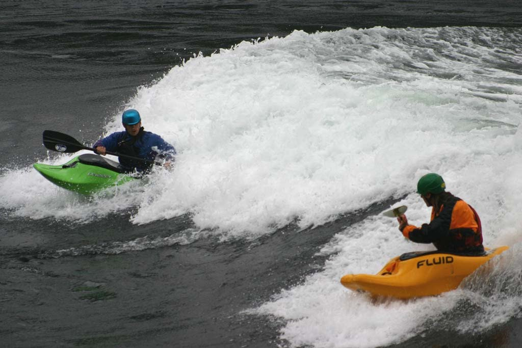 Kayakers fight the white water in the Narrows.