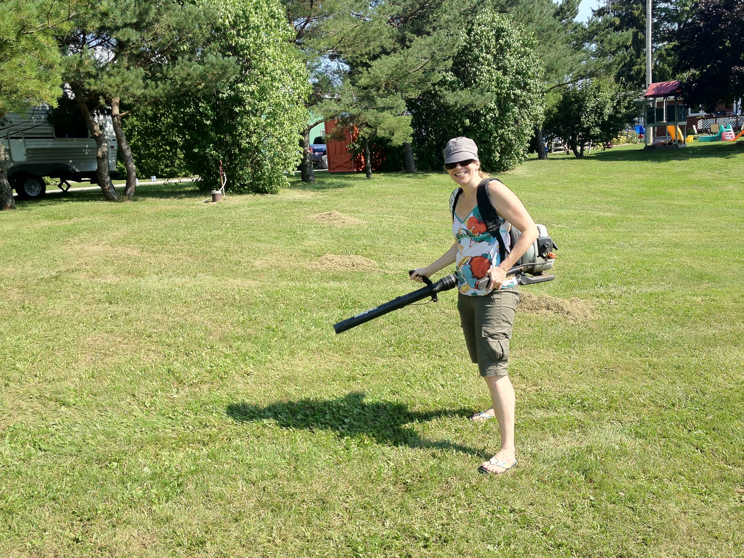 "Justine got to play with some of Shawn's ""toys"". She really liked the leaf blower as we raked up the grass on the lawn."